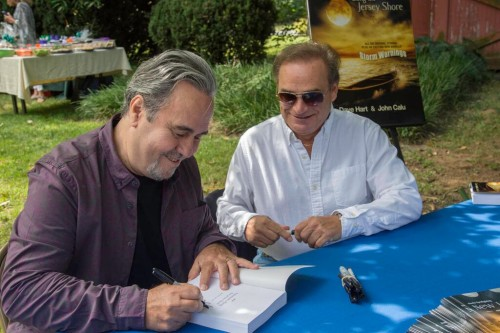 John and Dave signing a copy of Adventures Along the Jersey Shore